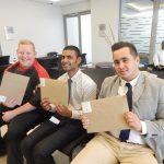 Happy candidates with their country club interview packs